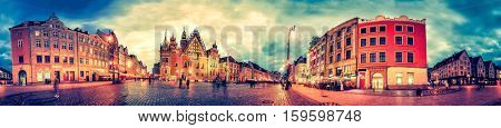 Wroclaw Market Square with Town Hall during sunset evening, Poland, Europe. Panoramic montage from 27 HDR Photos with post processing effects