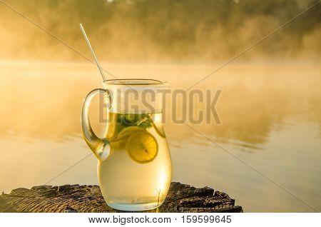 lemon ice fog. fresh citrus at dawn. drink in the morning mist. thick morning fog. lemon drink with ice fog.