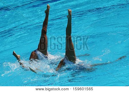 RIO DE JANEIRO, BRAZIL - AUGUST 15, 2016: Huang Xuechen and Sun Wenyan of team China compete during synchronized swimming duets free routine preliminary of the Rio 2016 Olympic Games