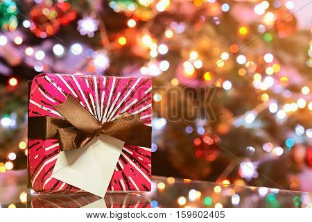 New year gift colourfull boxstand on glass table with blur background copy space