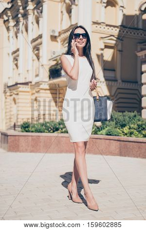 Portrait Of Pretty Business Woman Walking Outdoor And Talking On Phone