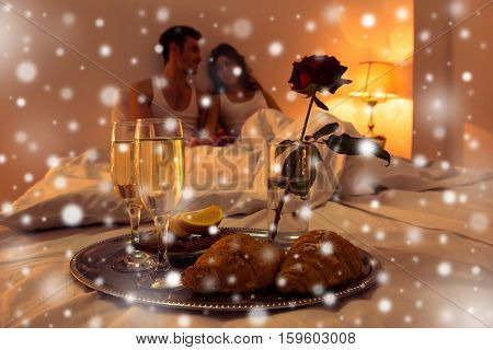 Couple In Love Having Romantic Supper In Bedroom On Xmas