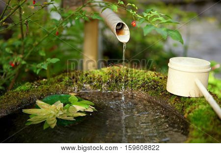 Japanese Water Source And Ladle For The Purification Of Hands