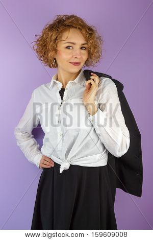 Businesswoman in white blouse on violet background