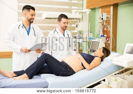 Two Doctors Checking On A Pregnant Woman