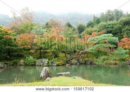 Beautiful Autumn Landscape Of Arashiyama, Kyoto, Japan. Photo Taken At Foggy Day