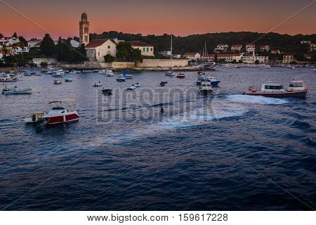 Waterfront sunset view af famous mediterranean touristic destination, in Croatia, town Hvar seascape, Europe.