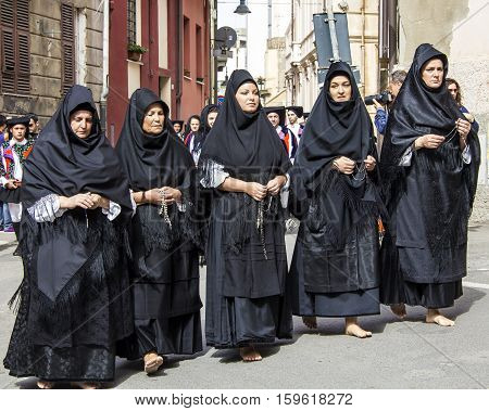 CAGLIARI, ITALY - May 1, 2013: 357 Religious Procession of Sant'Efisio - Sardinia - group of women in traditional Sardinian costumes