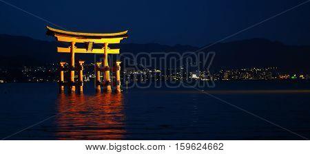 Nightview Of Beautiful Torii Gate In Miyajima, Japan