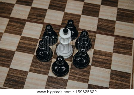 white King, surrounded, by, pawns, on, the, board