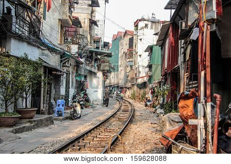 Editorial Image of rails trough the city of Hanoi - January 2014