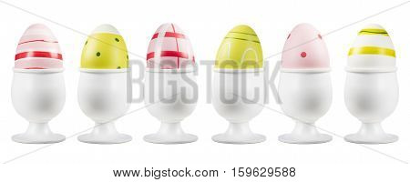 colorful easter eggs on eggcup on white background