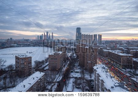Residential district, racetrack and third transport ring in Moscow, Russia at winter, evening view