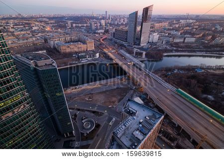 New building under construction, Third Transport Ring, bridge, river at evening in Moscow, Russia