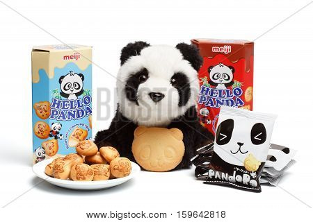 KYIV UKRAINE - Oktober 04 2015. Editorial photo of Hello Panda Milk Cream and Chocolate Biscuits by Meiji Holdings Co.Ltd. Pandaro Butter Cookies by Yaokin company and plush panda toy