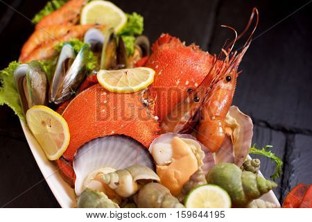 Seafood platter with ice on slate in restaurant