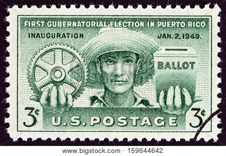 USA - CIRCA 1949: A stamp printed in USA issued for the 1st Gubernatorial Election in Puerto Rico shows Puerto Rican, Cogwheel and Ballot Box, circa 1949.