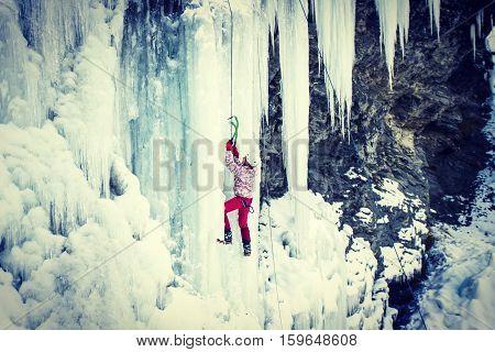 Ice climbing the North Caucasus,man climbing frozen waterfall.