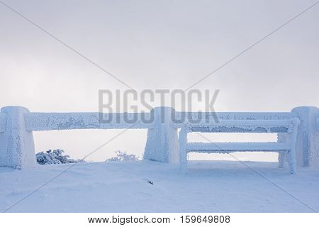 Snowy bench in winter at Czech highlands