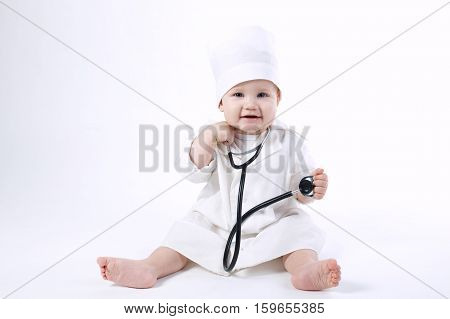 photo of cute little boy playing doctor