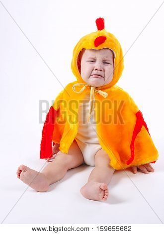 little funny boy in chicken costume on white