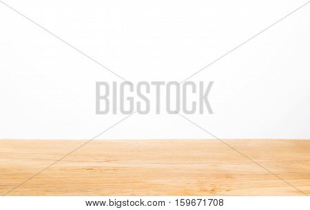 light color wood table top against white background selective focus on center of the wood table with blurred foreground and background