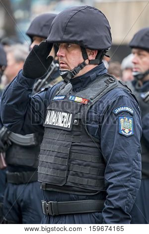 TIMISOARA ROMANIA - DECEMBER 1 2016: Military parade at Romanian National Day. Gendarmerie soldier officially give a salute. Picture taken in front of the Administrative Palace in Timisoara.