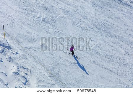 Mt. Titlis, Switzerland - 9 March, 2016: a person skiing. Titlis is a mountain of the Uri Alps, located on the border between Swiss Cantons of Obwalden and Bern mainly accessed from the town of Engelberg on the north side.