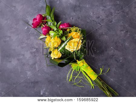 Bouquet of yellow, pink roses.. Still life with colorful flowers. Fresh roses. Place for text. Flower concept. Fresh spring bouquet. Summer Background