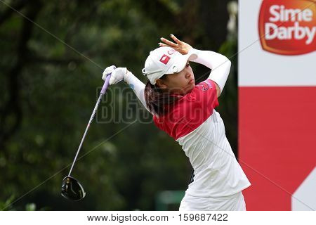 KUALA LUMPUR, MALAYSIA - OCTOBER 29, 2016: Kelly Tan of Malaysia tees off from the T-box of the 4th hole at the TPC Golf Course at the 2016 Sime Darby LPGA Malaysia golf tournament.