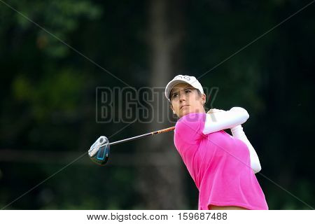 KUALA LUMPUR, MALAYSIA - OCTOBER 29, 2016: Azahara Munoz of Spain tees off from the 1st T-Box of the TPC Golf Course at the 2016 Sime Darby LPGA Malaysia golf tournament.