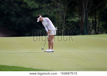KUALA LUMPUR, MALAYSIA - OCTOBER 29, 2016: So Yeon Ryu of South Korea putts on the green at the TPC Golf Course at the 2016 Sime Darby LPGA Malaysia golf tournament.