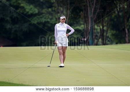 KUALA LUMPUR, MALAYSIA - OCTOBER 29, 2016: So Yeon Ryu of South Korea waits for her turn to play on the green at the TPC Golf Course at the 2016 Sime Darby LPGA Malaysia golf tournament.
