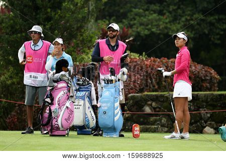 KUALA LUMPUR, MALAYSIA - OCTOBER 29, 2016: LPGA golfers and their caddies wait to tee off at the TPC Golf Course at the 2016 Sime Darby LPGA Malaysia golf tournament.