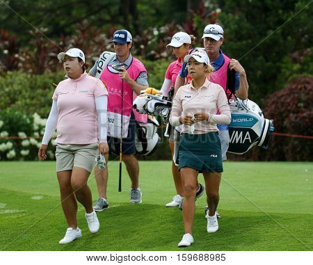 KUALA LUMPUR, MALAYSIA - OCTOBER 29, 2016: LPGA golfers walks to the fairway after tee off at 1st T-box of the TPC Golf Course at the 2016 Sime Darby LPGA Malaysia golf tournament.