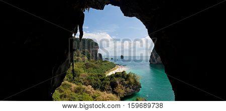 Tropical beach view from karst cave. Krabi, Thailand