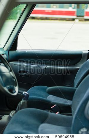 Front seats inside car. Two chairs drivng wheel in vehicle.