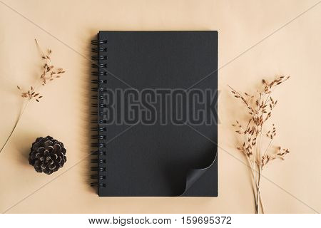 Dry flower with blank notebook in workspace Vintage tone