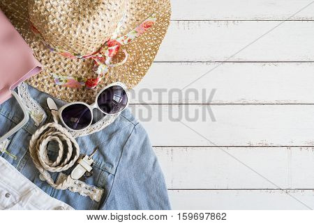 Overhead view of women cloths accessories and cellphone