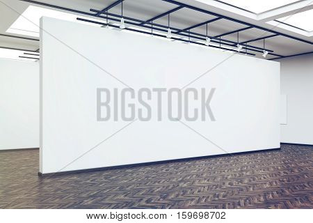 Side View Of A Large Blank Wall In An Art Gallery With Dark Wood Floor, Toned