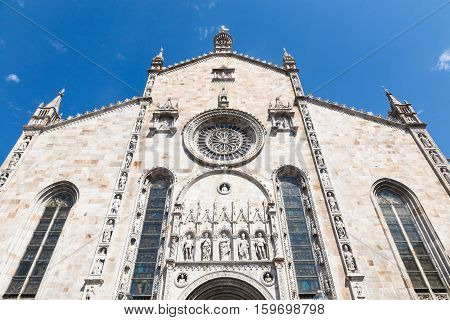 The facade of the white marble duomo or cathedral of Como on the Como Lake in Lombardy Italy