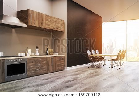 Side view of a kitchen interior with black wall kitchen counter an oven and a large table. 3d rendering. Toned image