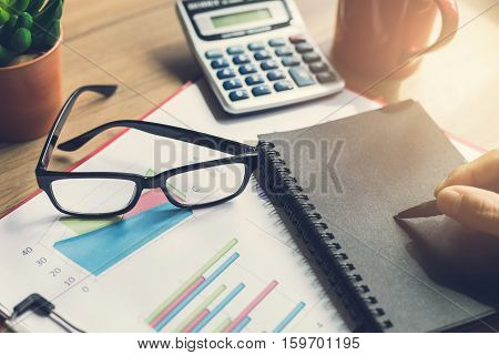 Desk office business financial accounting calculate Graph analysis