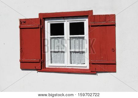 Windows / A window with shutters .