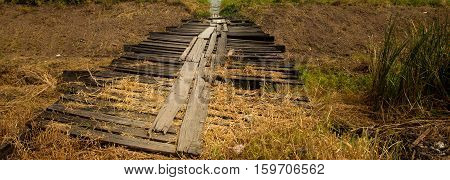 old temporary wooden bridge over the river