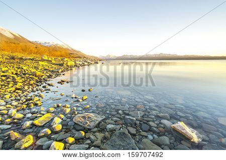 Lake stone and rock during sunrise moment