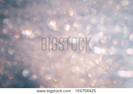 Christmas lights bokeh background pastel pink with silver specks