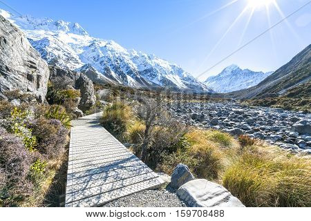 Hooker valley walking trek with sun flare at Mouth Cook New Zealand