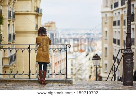 Female Tourist Enjoying City View On A Street Of Montmartre