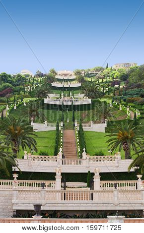 HAIFA ISRAEL - CIRCA SEP 2016: View of the Bahai Gardens with lower terraces. Palm trees empty stairs and clear blue sky